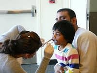 dentist checking boy's mouth