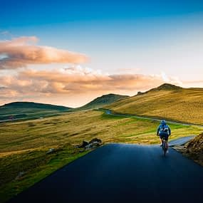 a cyclist cycling in nature