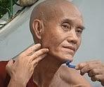 old man shaving